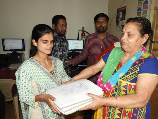Beneficiary receiving braille books to read!!!