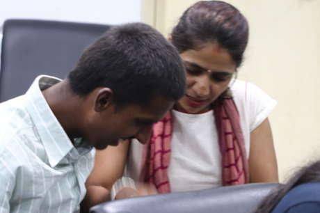 Help blind children use computer with braille