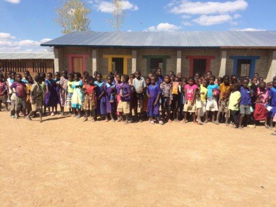 The community celebrating the school block.
