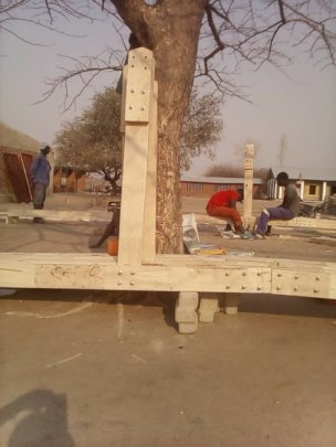 The roof trusses in progress for the classrooms