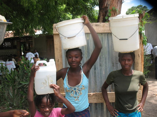 Girls carrying clean water