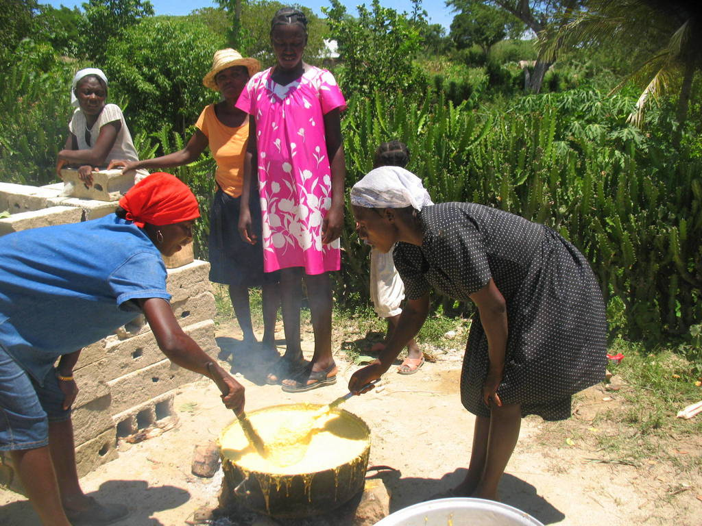 Haitian women cooking a meal for their community.