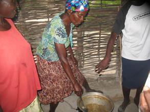 Women using clean cooking methods