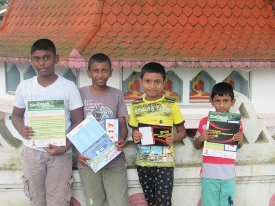 Children with the leaflets handed out at the event