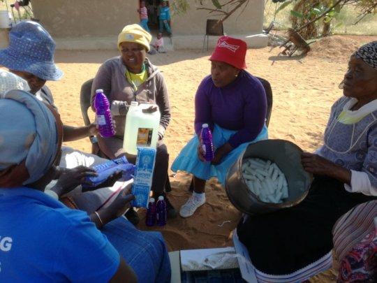 Mmwangwana group members about to make floorpolish