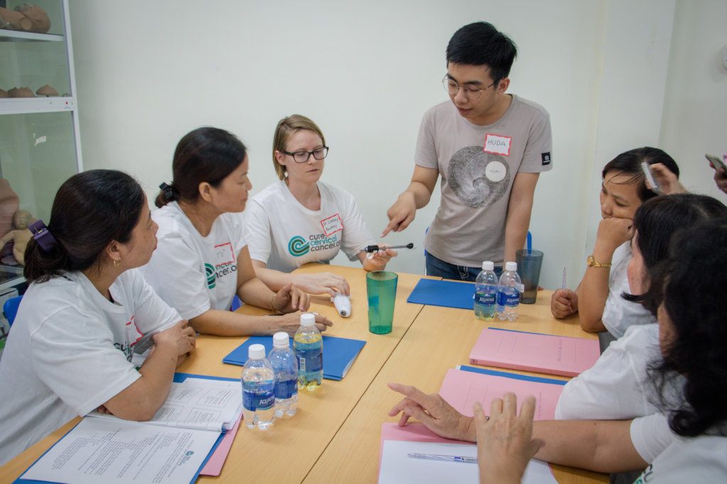 A trainer demonstrates disinfection