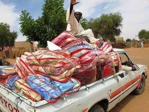 A blanket delivery arrives in Darfur