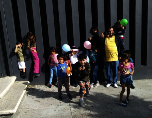 Coordinator Carlos with the happy and active kids