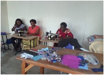 Learning to make re-usable sanitary towels.