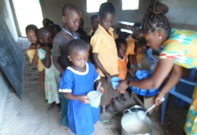Zuwera serving children breakfast