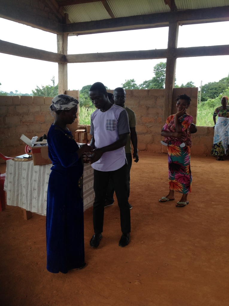 Akosua receiving supplements from Jesse.