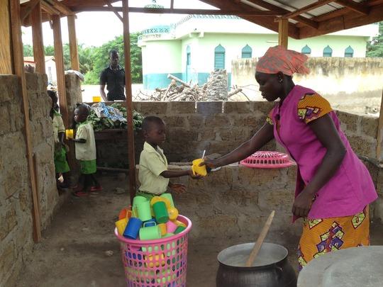 Children line up to get their meals
