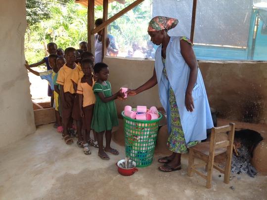 Auntie Nana, caterer, serves students QPM porridge