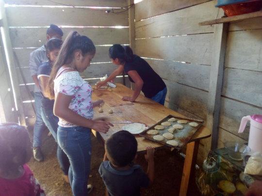 Young women making bread