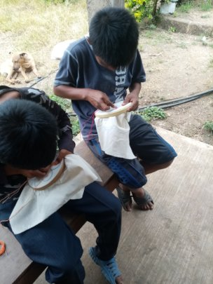 Young children in sewing and embroidery training