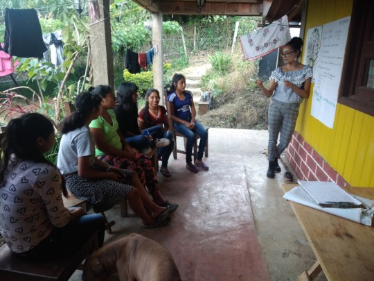 Young women receiving training.