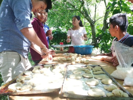 Young people making bread