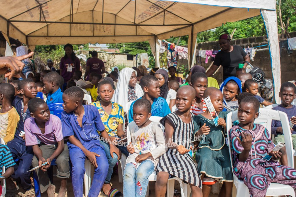 Children seated awaiting oral health examination