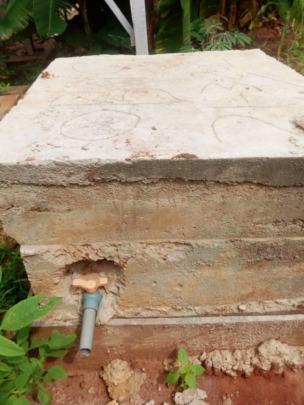 Restored Sumo pump encased in concrete