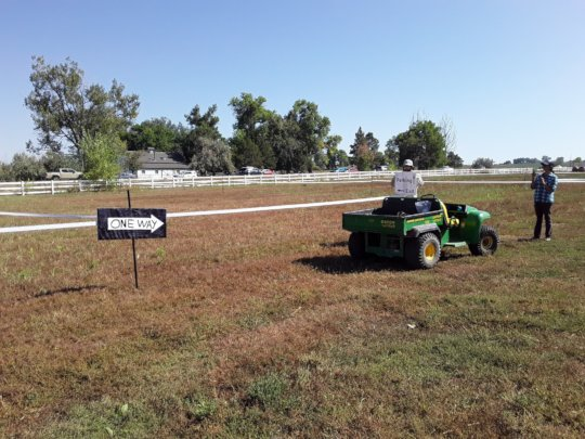 More fence work, and signage for overflow parking.