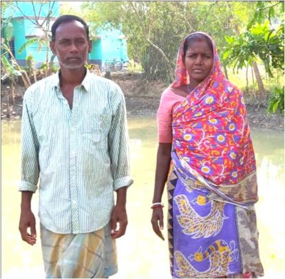 Ruipada* with his wife at his homestead Pond