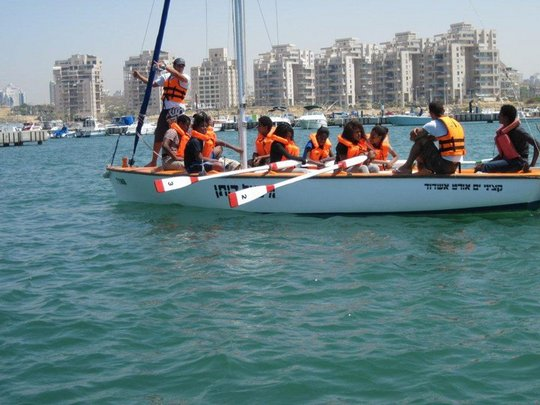Learning team work through water sports