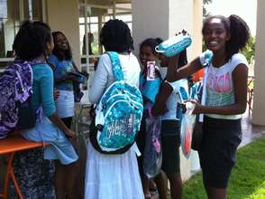Participants receive new school backpacks/supplies