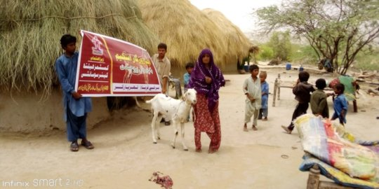 Women happy after getting Goat for her Family