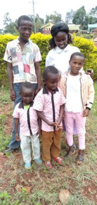 Hannah with her four children who we support