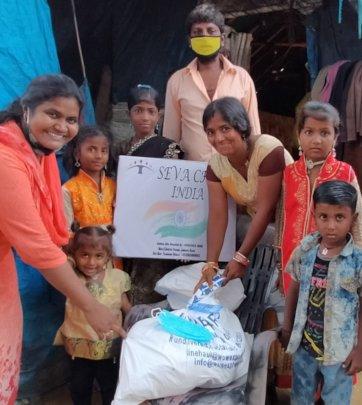 Poor family receiving food rations in Hyderabad