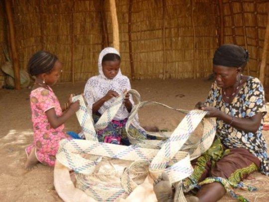 RAIN mentor and students weaving tabarma mats