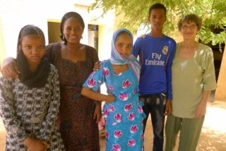 Halima (2nd from L) with students & founder Bess