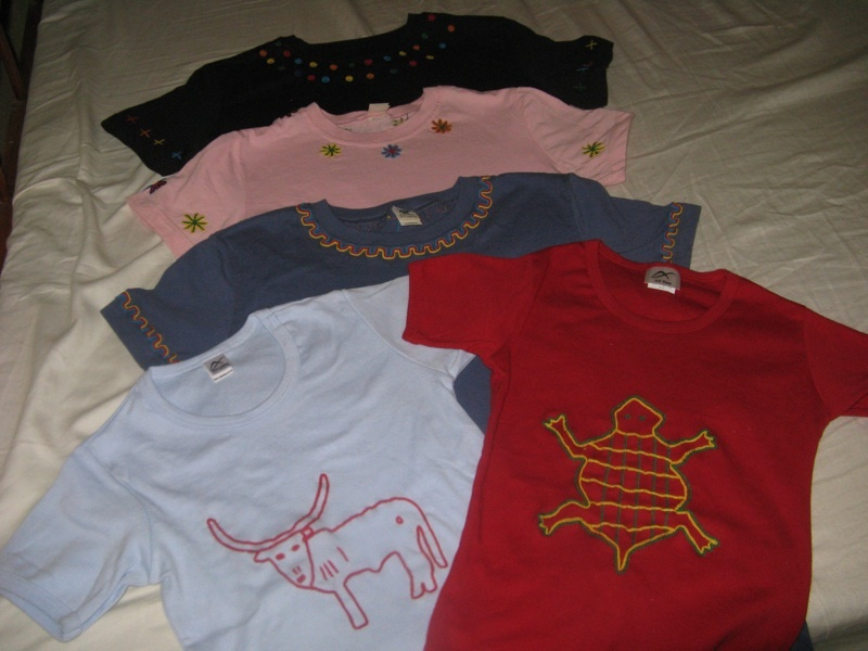 Beautifully embroidered tee shirts by the women.