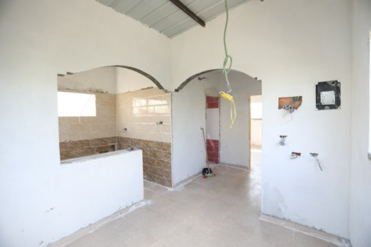 Kitchen and bathroom (w/ red tiles) on the left