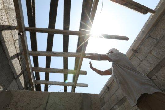 A new roof. Nylon tarps no longer needed.