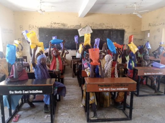 ChildVoice students receiving hygiene kits