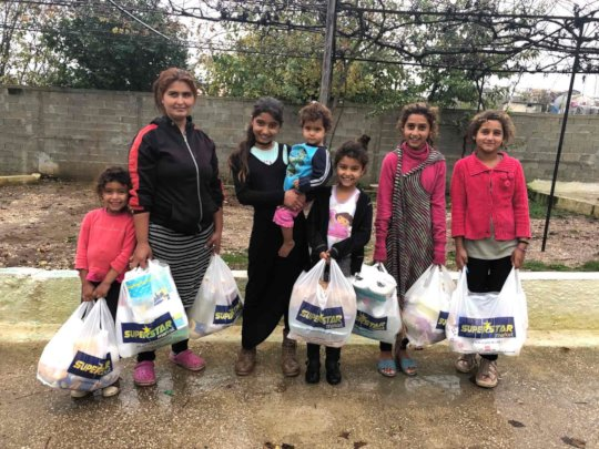 A family with aid delivery