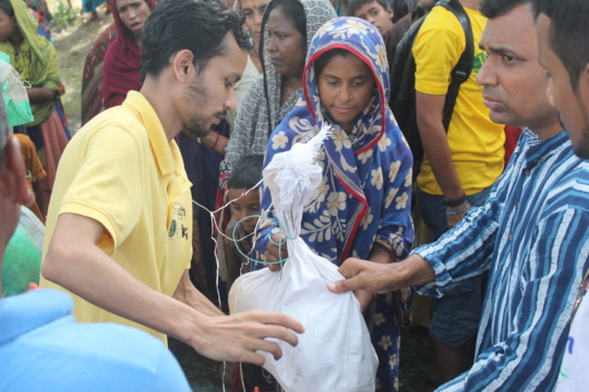 Volunteers Distributing Aid to Flood Victims