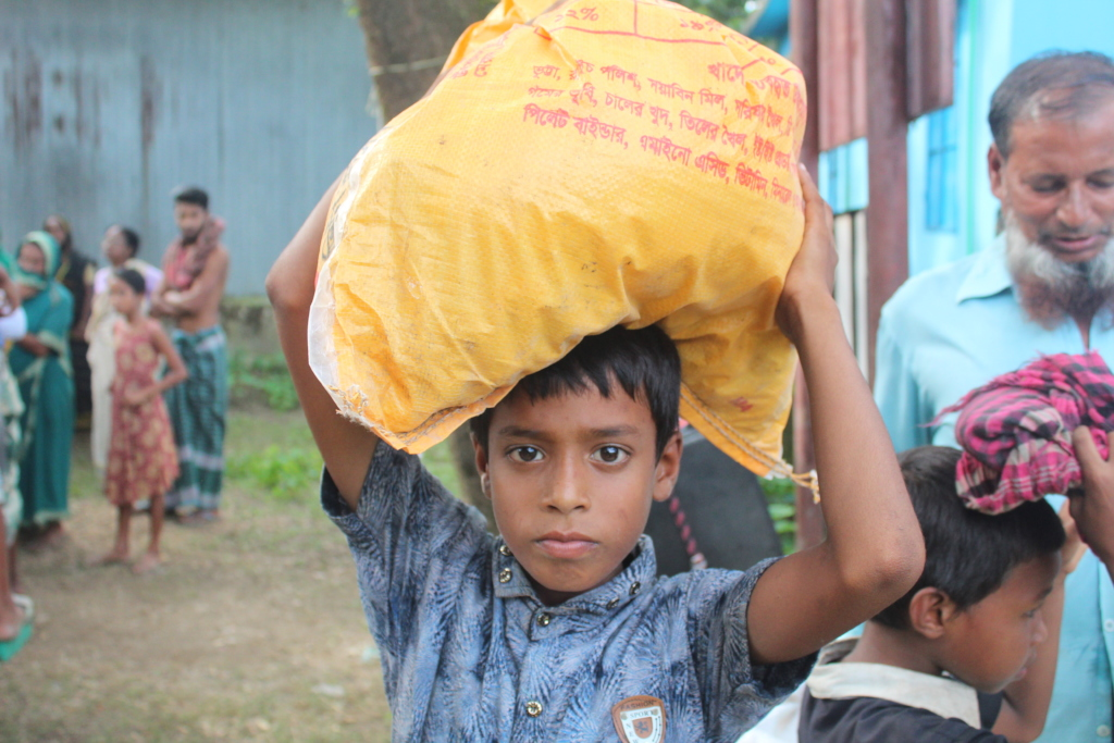 A Child After Receiving Relief Items