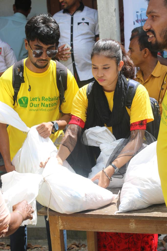 Volunteers Distributing Aid to Flood Victims
