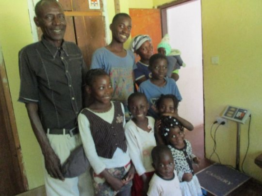 Tiko night watchman with his wife, (grand)children