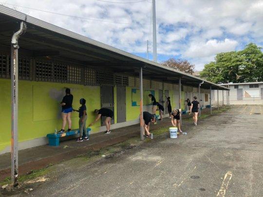 Volunteers painting the Santiago School