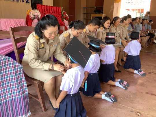 All teacher give a blessing to the children