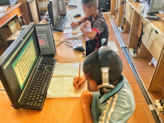 Figure 4: Kids taking notes