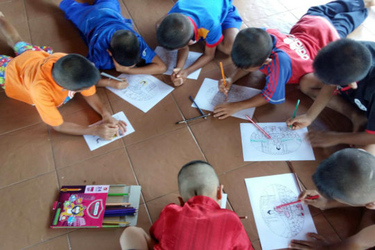 Figure 3: Grade 1 students using coloring pencils