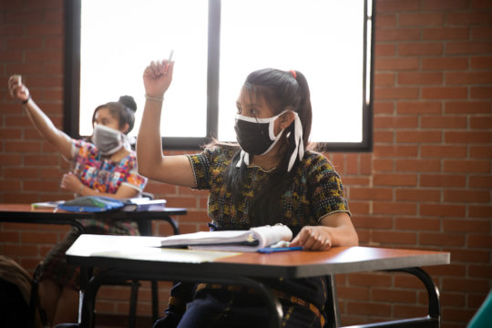 Girl Pioneers actively engaging in a class