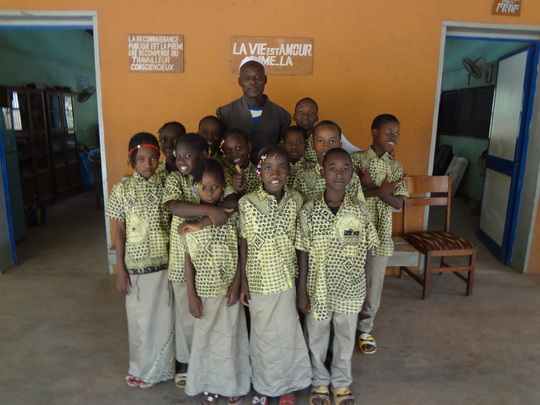 Children with their school principal