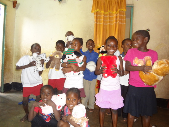 Children with gifts received from donors in the U.