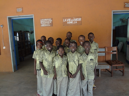 children in front of their classroom
