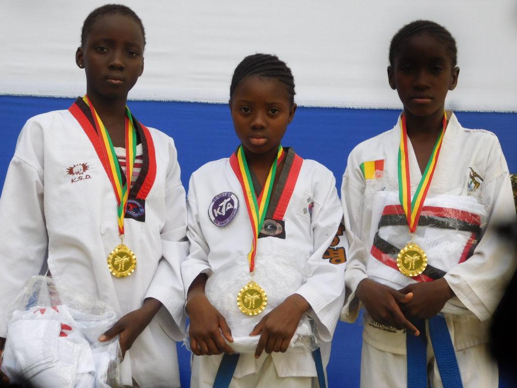 Diakassan, Kadiatou and Astan with their Gold Meda